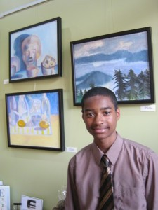 Hyattsville resident Romare Marshall, 14, and some of his award-winning art. Photo by Susie Currie.
