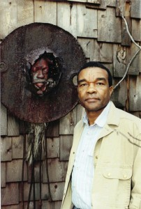 Artist and collector David Driskell, outside the studio he built behind his Hyattsville home. with a ceramic-and-metal piece created by Bing Davis. Photo courtesy Driskell family.