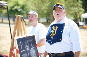 """Pictured (L-R): """"Zag"""", Mark Kubacik and """"Pops"""", Gene Meacham of the Potomac 9 of Gaithersburg watch their side bat against the pitching of the Cecil Club of Chesapeake City at Magruder Park in Hyattsville, MD on Sunday, July 31st, 2011."""