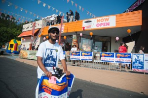 Dunkin' Donuts employee Mark Simon of Queens Chapel volunteers at the Cops on Rooftops fundraiser for the Special Olympics at the Dunkin' Donuts owned by Ray Omar at 3030 Queens Chapel Rd. Chillum.  Photo courtesy William Jenne.
