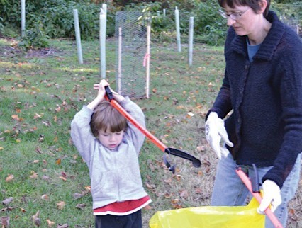 Lara Oerter and son Toby team up for a trash cleanup organized by the local chapter of Roots & Shoots. Photo courtesy Maureen Vosmek.