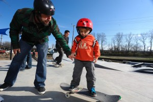 Thomas Roszkowski of Silver Spring coaches his son Grey (3) at the nearly finished Melrose Skate Park. Photo courtesy William Jenne.