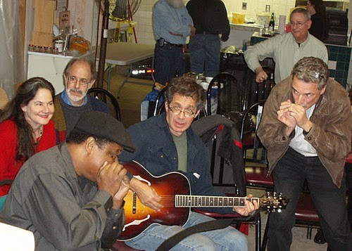 Local musicians gather in the historic Riverdale Park trolley station for the Archie Edwards Blues Heritage Foundation Holiday Party in December 2011. Photos courtesy Jim Lande.