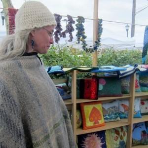 Hyattsville quilter Cynthia Gossage surveys her work at the West Hyattsville arts festival Handmade on Hamilton. Photo courtesy Susie Currie (November 2012).