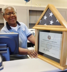 A fixture at the Hyattsville Post Office for decades, Pam Davis-Daniels retired on November 30, 2012. Mayor Marc Tartaro presented her with a flag and official proclamation of thanks on her last day. Photo courtesy Bill Holland.