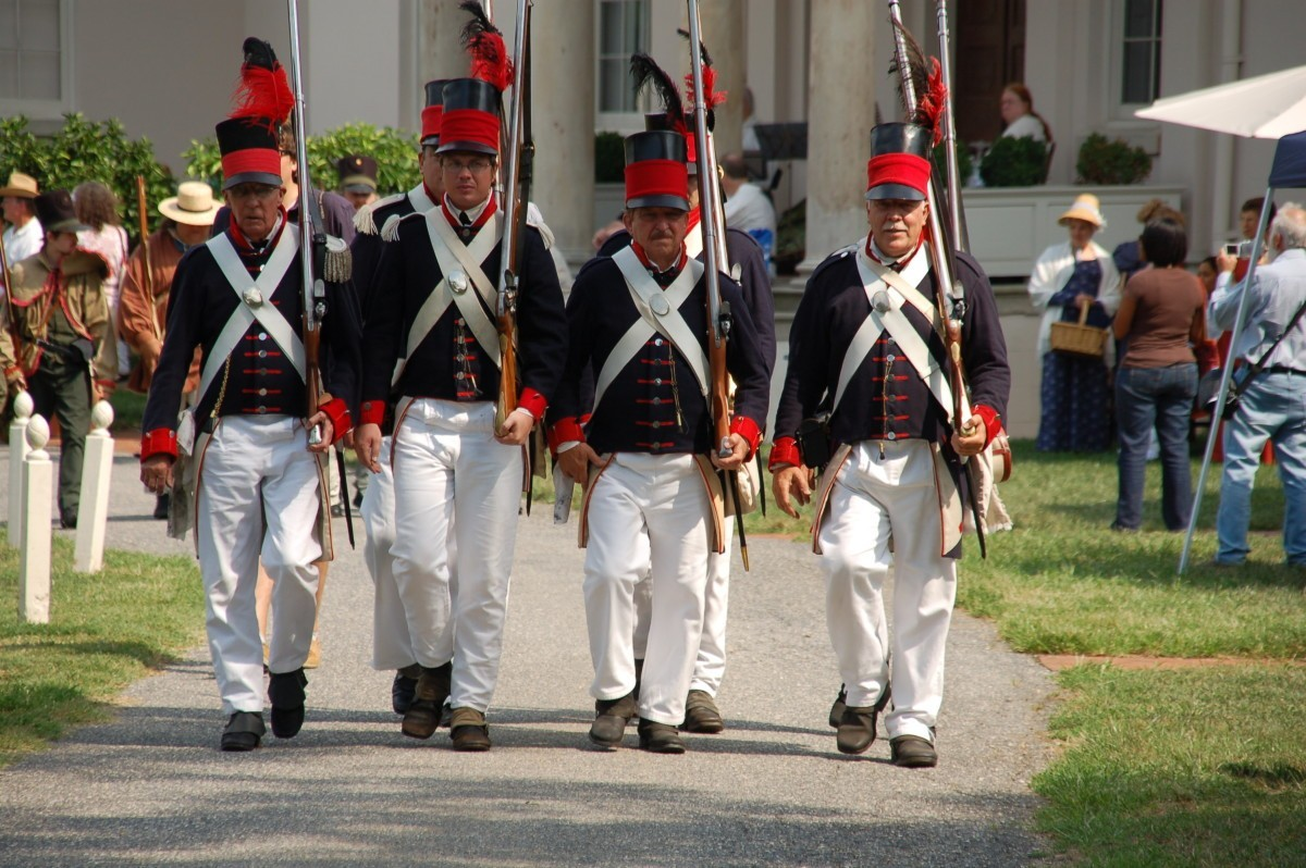 Members of the Baltimore United Volunteers march in formation in front of Riversdale.