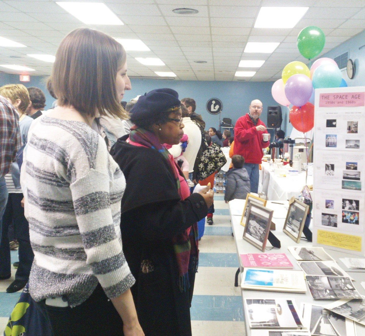 During the 50th-birthday bash for the Hyattsville library on March 2, visitors gathered in the ground-floor meeting room for a glimpse of the library's long and rich history.  Courtesy Gray O'Dwyer