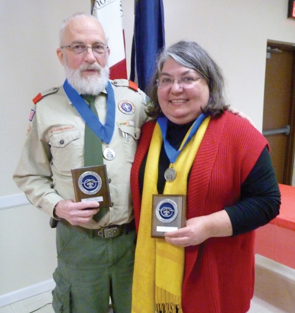 Troop 224 Scoutmaster Bill Thomas and his wife, Dr. Cathleen Hapeman, were awarded the Prince George's Scouting District Award of Merit on February 8. Since he became scoutmaster in 2001, the number of Eagle Scouts from the troop has skyrocketed. Credit: Colleen Aistis