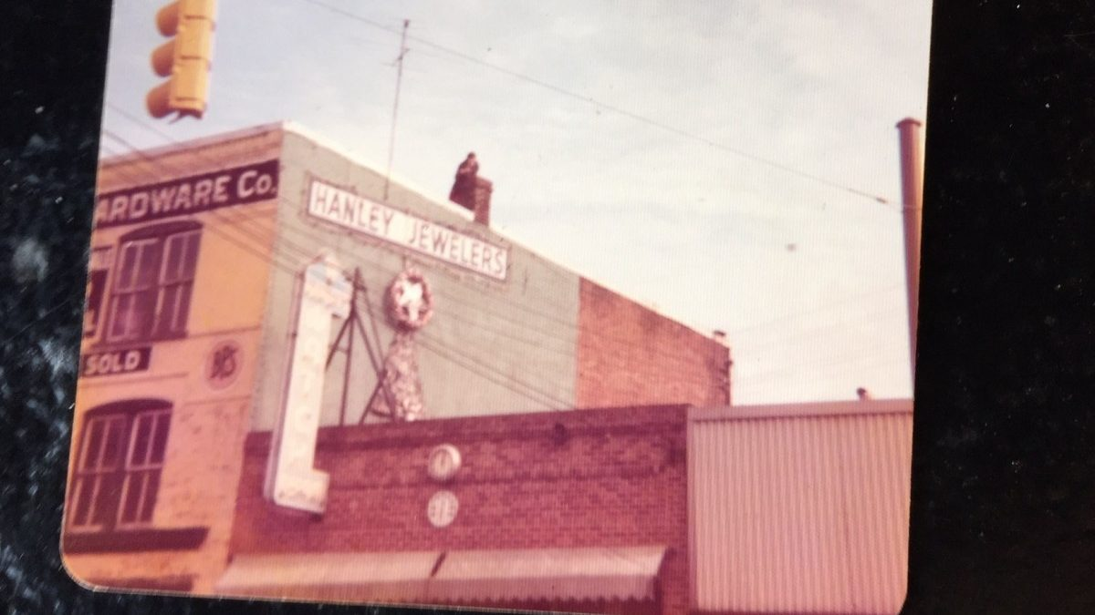 Postcards from the Past: Hanging Christmas lights at Hanley Jewelers
