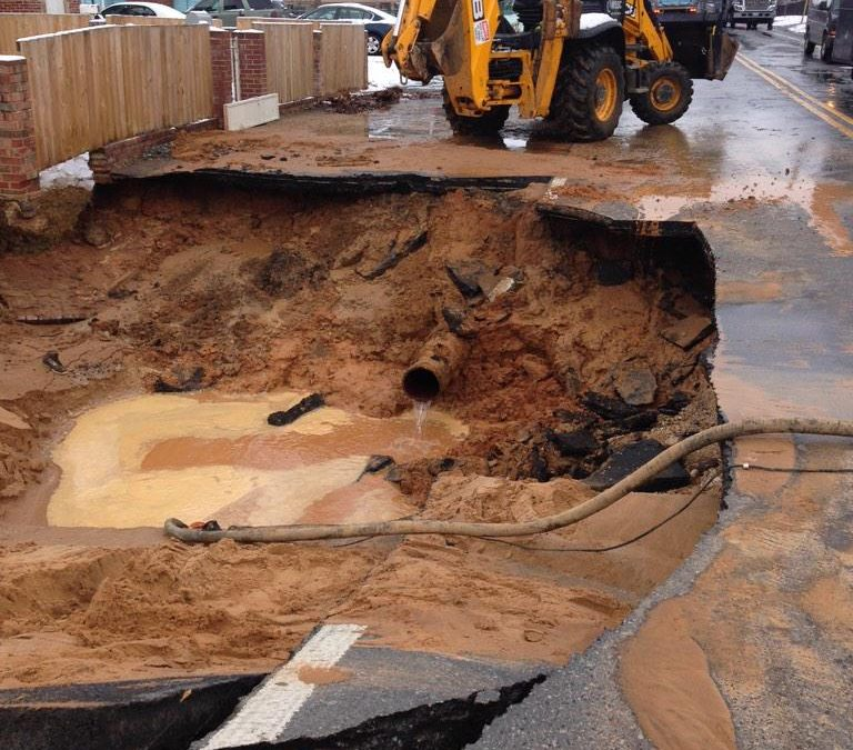 Family narrowly escapes sinkhole caused by water main break