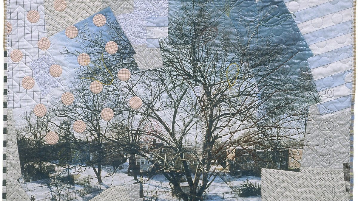 Good neighbors: a 1996 quilt hangs in the city building