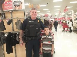 HCPD Cpl. Denault with his shopper. Photo courtesy Rebecca Bennett.