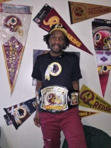 Paul Wilson is pictured in his Hyattsville home wearing his championship belt in hopes for a good season. Not pictured are the Redskins Reeboks he is wearing.
