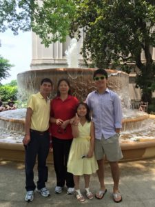 Hui Li (far right) stands along with his parents and younger sister.