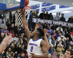 DeMatha basketball wins 14th in a row; jersey patches honor Coach Wootten