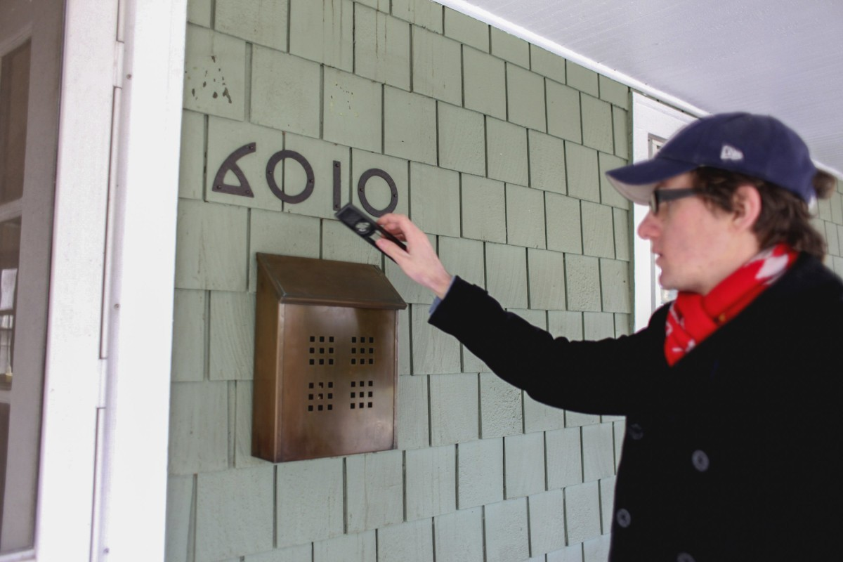 Steve Spencer touches up his house number before the 2012 HPA home tour.