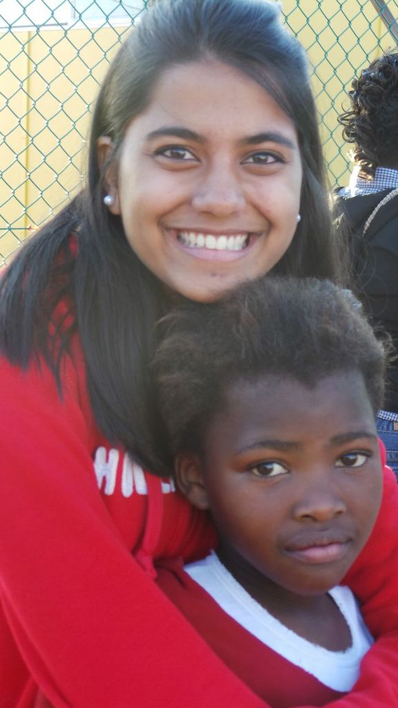 Northwestern High School choir member Sharada Weaver and a student she met at South Africa's Amy Biehl School. Photo by Leona Lowery Fitzhugh. (August 2013)