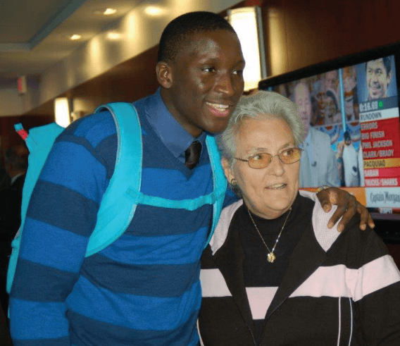 Victor Oladipo, certain to be a first-round NBA draft pick this month, will be the first St. Jerome alum to play  professional basketball. He reunited with his middle-school teacher, Janice Volpini, at a May reception in his  honor hosted by his high school alma mater, DeMatha. Photo by Mike Murray.