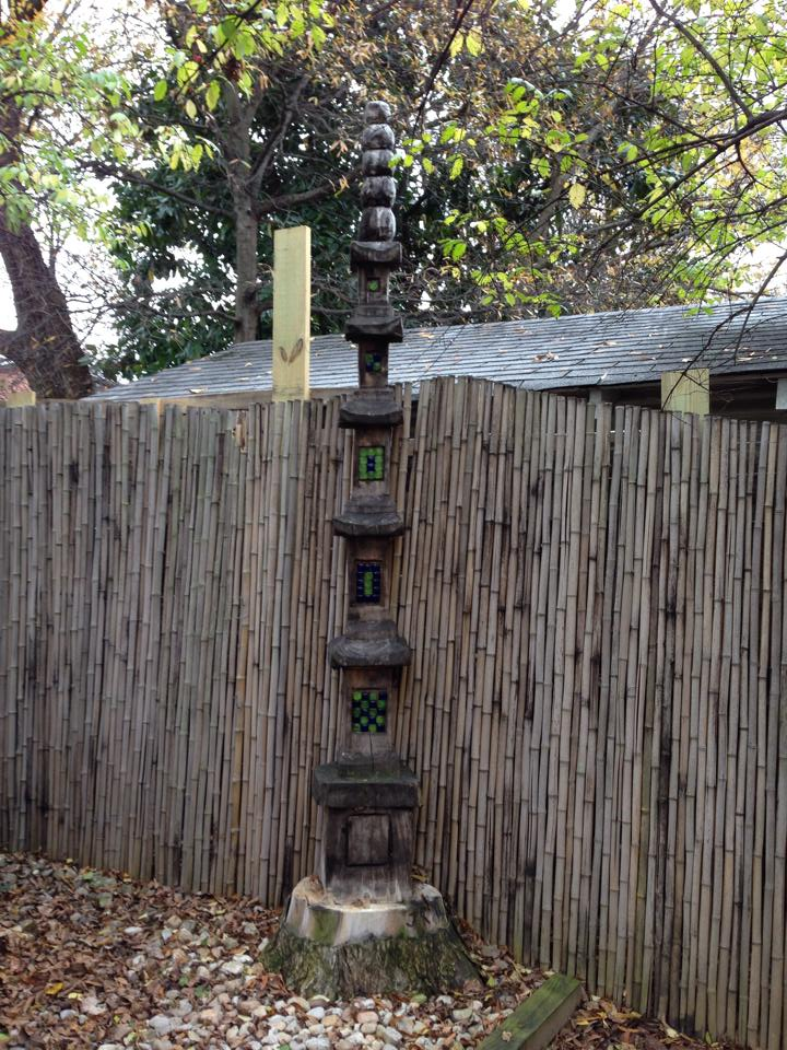 A tree carved as a pagoda with a chainsaw located on 41st Avenue). Rucker said she consulted on this garden and made the suggestion to carve the tree trunk rather than remove it entirely.  Photo courtesy Liberty Rucker.