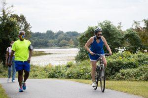 People walking and biking around Lake Artemesia