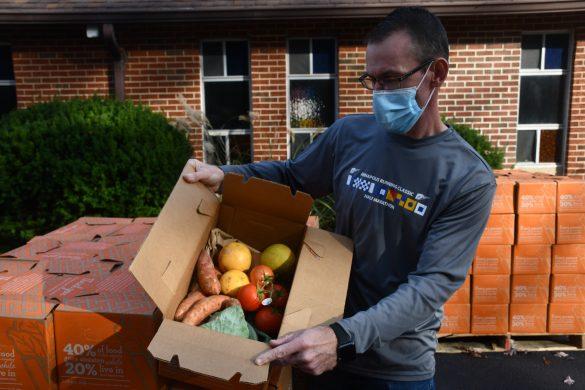 Mark Garrett with box of food