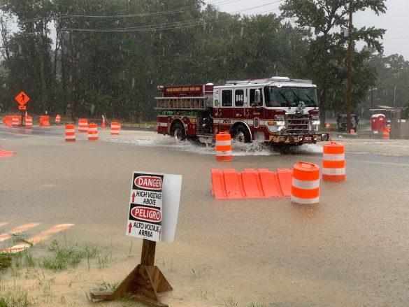 firetruck going through September flood waters