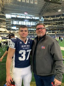 Ethan Gough, pictured with his father, Craig, was invited to the Arlington, Texas game as one of the top long snappers in the nation